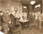 Office with nine men photo dated 1924 Newspaper Enterprise Assoc OM.jpg (50983 bytes)